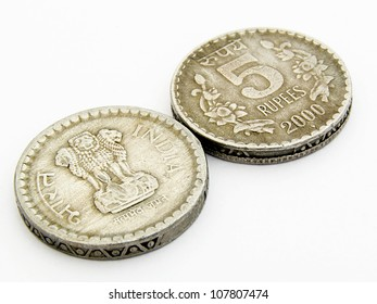 A image showing 5 rupees old used indian coins with head & tail side on isolated white background.