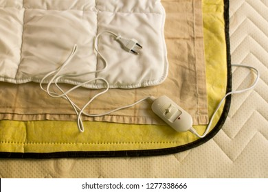 The image is showing how to use electric blanket on bed.Close up taken,top view.