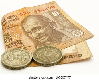Image showing Indian 10 rupee note with 2 5 rupees coins with image of Mahtma Gandhi on note.