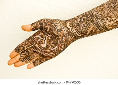 A image showing isolated hand of an Indian bride with herbal heena.