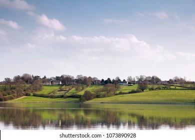 An image showing the Village of Upper Hambleton shot across Rutland Water, Rutland, England, UK