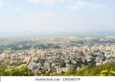 The image shows the aerial view of Satara city in Maharashtra, India. It was captured from the top of Ajinkyatara Fort.
