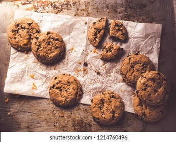 image shows a baking tray or cookie sheet with chocolate chip cookies - topview