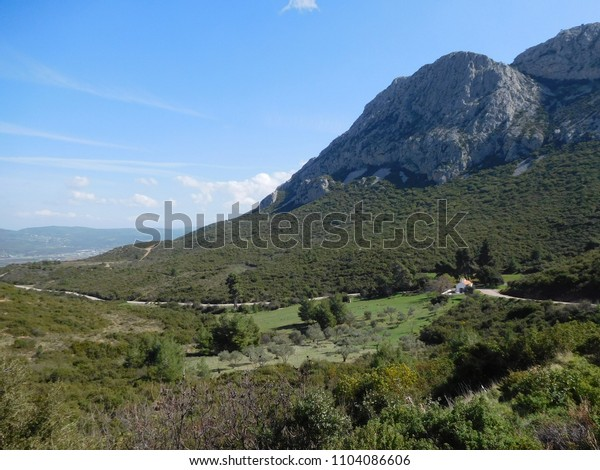 Image shows a beautiful mountain landscape with blue background sky.