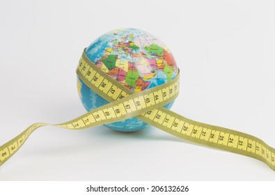Image shows a globe with a measure tape isolated on white background