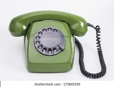 Image shows a green retro telephone isolated on a white background