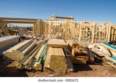 Image shows a home under construction at the framing phase.  Ideal for home construction advertising and other home construction promotional inferences.