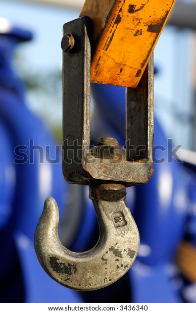 Image shows a hook from an industrial crane