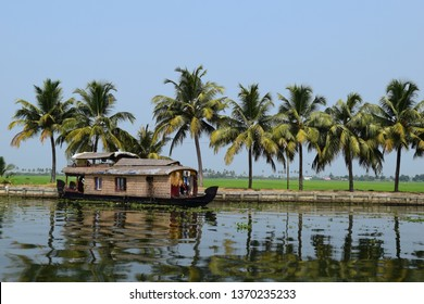 Image shows a house boat in the back waters of Kerala. Kerala is known for its natural beauty. Kumarakom in Alapuzha district is known as the Venice of the east. Kumarakom is famous for the House Boat