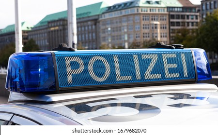 The image shows a light bar on a police car in Germany