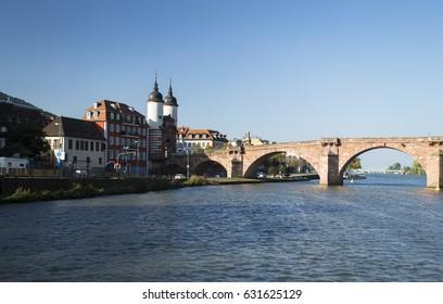 Image shows an old bridge over the river Neckar in Heidelberg