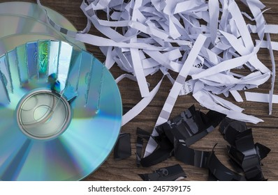 Image shows paper shavings, mag tape shred and compact disks