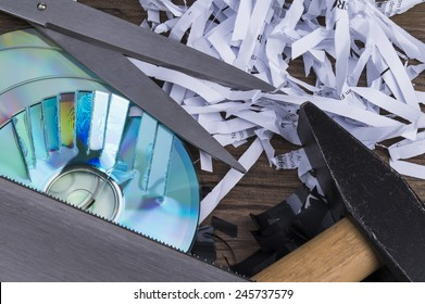 Image shows paper shavings, magtape shredd, compact disks and some tools