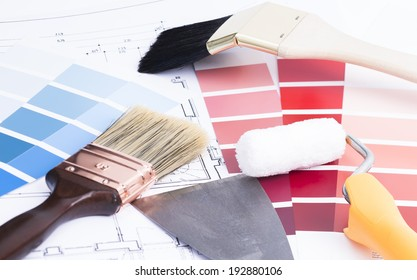 Image shows some brushes a painter roller and color palette
