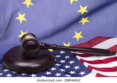 Image shows a wooden in front of a european and u.s.a flag