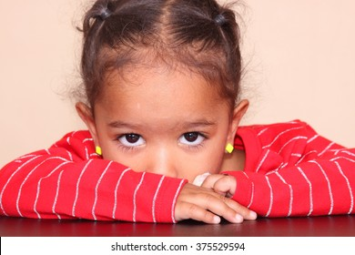 Image of a shy, little girl.