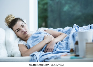 Image of sick woman lying in bed
