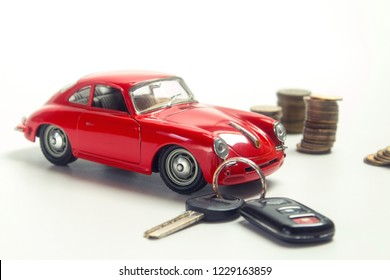 Image similar to a pile of silver coins with a red sports car model in a savings concept to buy a car or insure on a travel trip.