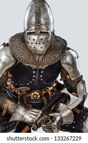 Image of sitting man in a knight costume