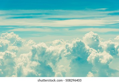 image of  sky and white clouds on day time for background usage. (vintage tone)