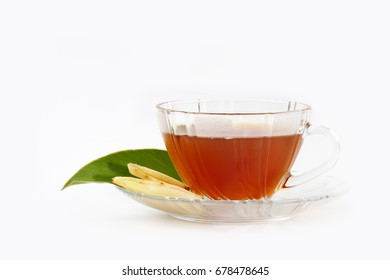 An image slice of fresh ginger root and tea isolated over white background.