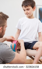 Image of small happy boy during kinesiology therapy