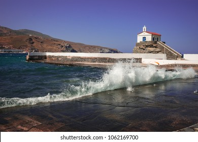 Image of small white church on the beach, Andros, Greece