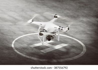 Image of small white drone going to take off
