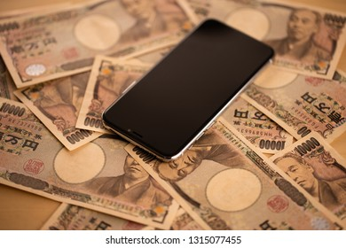 Image of smartphone and money