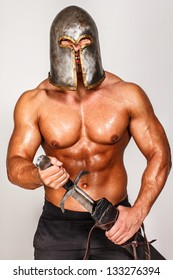 Image of smiling barbarian who is wearing only shorts and helmet