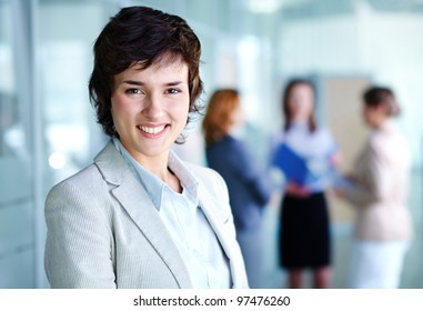 Image of smiling female looking at camera in working environment