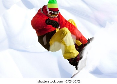 Image of snowboarder skating down mountain side