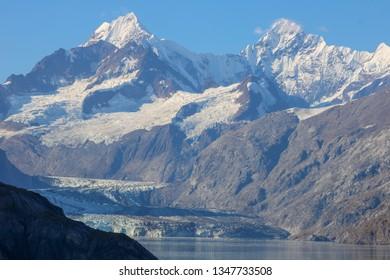 Image of snowy mountains in Alaska's notorious glacier bay.