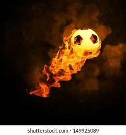 Image of soccer ball in fire flames against black background
