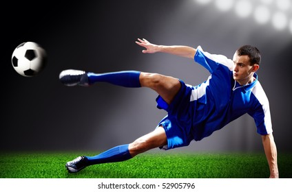 Image of soccer player doing flying kick with ball on football field
