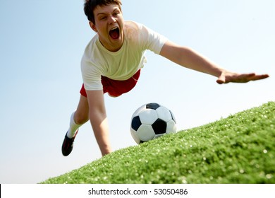 Image of soccer player falling down and shouting
