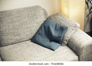 An image of a sofa with a cushion