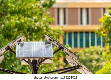 image of solar cell plate on steel tower day time.