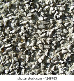 An image of some stones in a cemented wall.