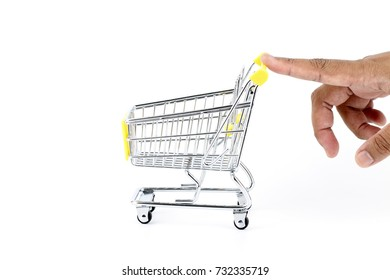 Image of someone pushing an empty trolley with fingers