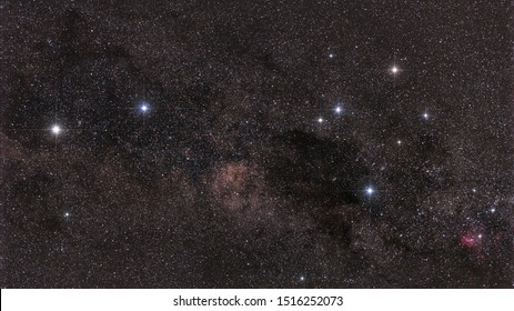 Image of the Southern Cross asterism in the constellation of Crux, together with the two so-called pointer stars, Alpha and Beta Centauri and the dark Coalsack Nebula.