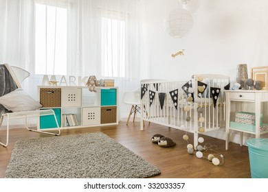 Image of spacious infant bedroom with white furniture