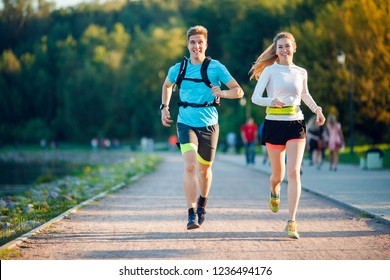 Image of sports men and women running in park