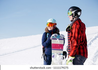 Image of sports woman and man with snowboard on vacation