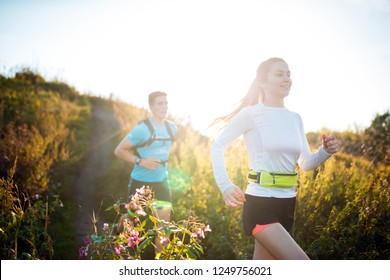 Image of sports women and men running along footpath