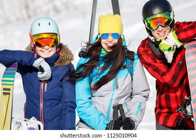 Image of sports women and men with snowboard on vacation
