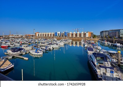 Image of St Helier Marina North section from the East marina wall early morning with blue skys and sunshine. Jersey, Channel Islands, UK