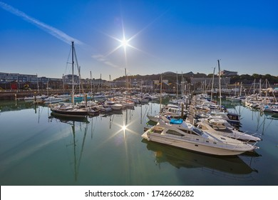 Image of St Helier Marina North section from the West Marina wall, early morning with blue skys and sunshine. Jersey, Channel Islands, UK