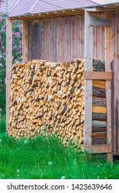 image of a stack of firewood near the house