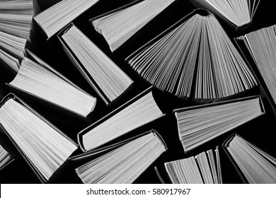 image of a stack of hard back books on the end  retro vintage monochrome background